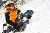 Junge mädchen mit snowboard — Stockfoto