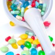 Mortar and pestle with pills - Stock Photo