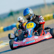 Stock Photo: Kart pilots competing