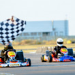 Kart pilots competing - Stock Photo