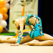 Unknown gymnast performs — Stock Photo