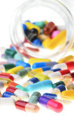 Many colorful pills isolated on white — Stock Photo