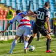 Stock Photo: GALATI, ROMANAI-MAY 08: Unidentified football players compete