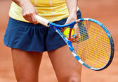 Detail of a tennis player arms — Stock Photo