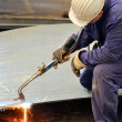 Stock Photo: Welder working at shipyard in day time