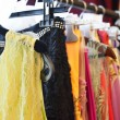 Fashion clothing on hangers at the show — Stock Photo