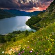 Majestic sunset in the mountains landscape over a calm lake — Stock Photo