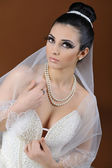 Portrait of a beautiful bride with bright makeup — Stock Photo
