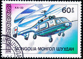 A stamp printed by MONGOLIA shows helicopter — 图库照片