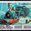 A stamp printed in Guinea showing an old railroad steam engine — Stock Photo