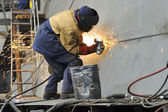 A welder working at shipyard in day time — Stock Photo