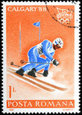 Stamp printed in Romania shows Slalom and Olympic emblem — Stock Photo