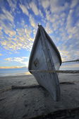 Boat on the beach at sunset time — Stock Photo
