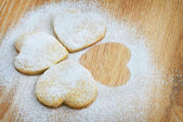 Christmas gingerbread cookies, sprinkled with powdered sugar, cl — Foto de Stock