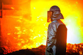 Worker with hot steel — Stock Photo