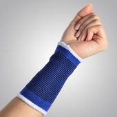 Hand with a orthopedic wrist brace — Stock Photo