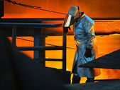 Worker with hot steel — Foto Stock