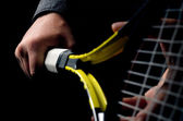 Hand on grip and swinging a tennis racket. Isolated on black bac — Stockfoto