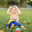 Baby boy playing with balls — Stock Photo