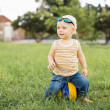 Baby boy on the green grass — Stock Photo