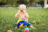 Baby boy playing with balls — Photo