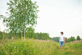 Young man on nature — Stock Photo