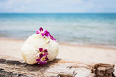 Bouquet on a beach — Stock Photo