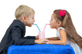 Boy and girl drink yoghurt. Isolated — Stock Photo