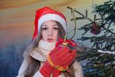 Cute teenage girl in santa hat — Stock Photo