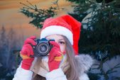 Santa girl with SLR camera — Stock Photo