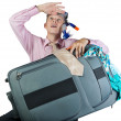 Dreaming office worker with travel bag — Stock Photo
