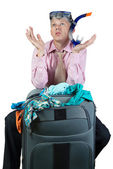 Embarrassed man with travel bag — Stock Photo