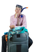 Thoughtful man with travel bag — Stock Photo