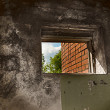 Stock Photo: Grunge wall with small window