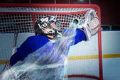 Hockey goalie miss the puck — Stock Photo