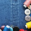 Color threads with buttons — Stock Photo
