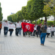 Tunisian people protesting at the Bouguiba Street, Tunis - TUNISIA — Stock Photo #28534301