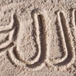 Постер, плакат: Allah Arabic writing on sand