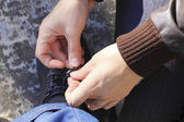 Woman Tying A Shoelaces On The Mans Shoes — Stock Photo