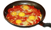 Fried eggs with tomato on the pan — Zdjęcie stockowe
