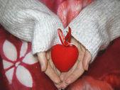 Valentine heart and heart shape candle in woman hands — Stock Photo