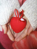 Valentine red heart in woman tender hands — Stock Photo