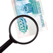 Loupe zooms banknote — Stock Photo
