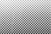 Metallplatte mit schwarzen Löchern — Stockfoto