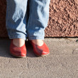 Royalty-Free Stock Photo: Legs in blue jeans and red shoes
