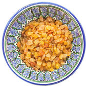 Sultana raisin in traditional central asian bowl — Stock Photo