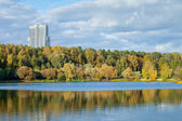 Autumn urban park on river bank — Stock Photo