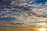 Sunrise in dark blue autumn sky — Stock Photo