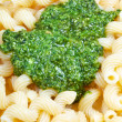 Italian pasta cavatappi with pesto - Stock Photo