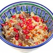 Traditional asian pilaf with pomegranate seeds — Stock Photo